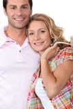 Couple returning from shopping trip Stock Image
