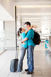Couple reunion. Happy young couple reunion at airport Royalty Free Stock Photos