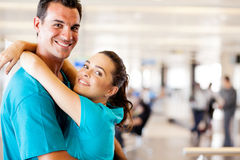 Couple reunion at airport. Happy young couple reunion at airport Royalty Free Stock Photography