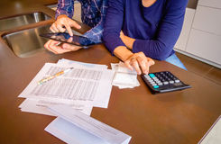 Couple reviewing their accounts with a digital Stock Photography