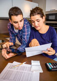 Couple reviewing their accounts with a digital Stock Photo