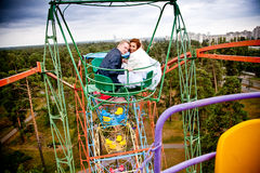 Couple ridding in tycoon park on ferris wheel Stock Image