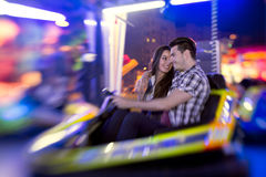 Couple ride bumper car Royalty Free Stock Image
