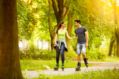 Couple ride rollerblades Royalty Free Stock Photo