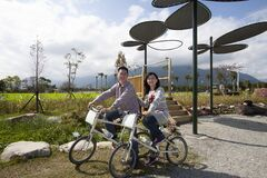 Couple riders in Taitung farm park, Taiwan
