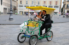 Couple rides a  quadricycle Stock Photography