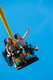 Couple riding on the attraction. Happy young couple riding on the attraction Stock Photos