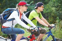 Couple riding bicycle Stock Image
