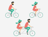 Couple riding bicycle. Hipster style. Young couple riding bicycle set Stock Images