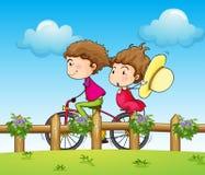A couple riding a bicycle Stock Photos
