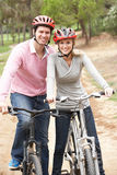Couple riding bicycle in park Royalty Free Stock Photography