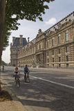 Couple riding a bicycle on the street of Paris Stock Photography