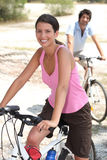 Couple riding bicycles Royalty Free Stock Images