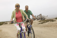 Couple Riding Bicycles On Beach Royalty Free Stock Photo