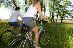 Couple riding bicycles by the lake Stock Photography