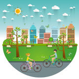 Couple Riding Bicycles In Public Park, Illustration, Flat Design. Couple Riding Bicycles In Public Park. Natural landscape in the flat style. a beautiful park Royalty Free Stock Photography