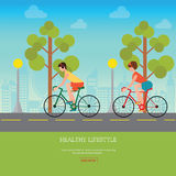 Couple Riding Bicycles on road . Stock Images