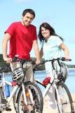 Couple riding bicycles Stock Photos