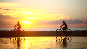 Couple Riding Bike at the Beach