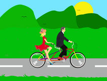 Couple riding a bike in the nature Royalty Free Stock Photo