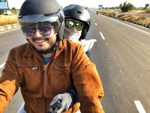 Couple riding a bike for their expedition in India. A couple from India riding on the roads of India for expeditions stock photo
