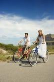 Couple Riding Bikes royalty free stock photo