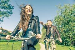 Couple riding on bikes Royalty Free Stock Photo