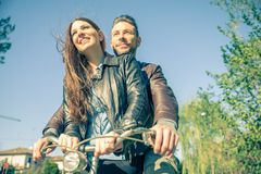 Couple riding on bikes Royalty Free Stock Photography