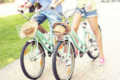 Couple riding bikes in the park Stock Photography