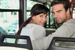 Couple riding the bus. Together Stock Photo
