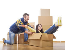 Couple riding in a cardboard box Royalty Free Stock Image