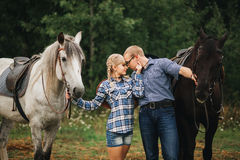 Couple riding in forest Stock Photo