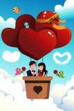 Couple riding a hot air balloon Stock Photos