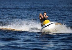 Couple riding jet ski Stock Photography