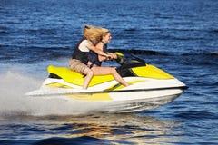 Couple riding jet ski Royalty Free Stock Images