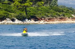 Couple riding on a jet ski in the Ionian Sea. Couple of people riding on a jet ski in the Ionian Sea Royalty Free Stock Photography