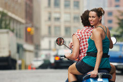 Couple Riding On Moped In Street Stock Image