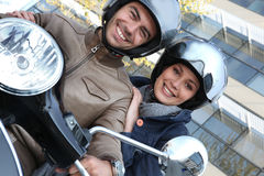 Couple riding a motor bike Stock Photo