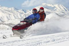 Couple Riding Motor Sledge Stock Photo