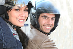 Couple riding motorbike Royalty Free Stock Photography