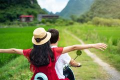 Couple riding motorbike around rice fields of Yangshuo, China royalty free stock image