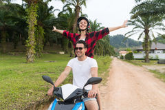 Couple Riding Motorbike, Young Man And Woman Travel On Bike On Tropical Forest Road royalty free stock images