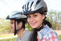 Couple riding mountain bikes Royalty Free Stock Photography