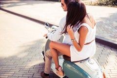 Couple riding a retro scooter Royalty Free Stock Photos