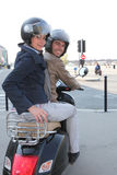 Couple riding a scooter Stock Image