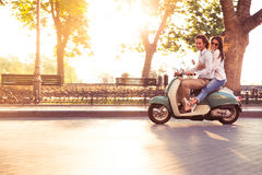 Couple riding a scooter and having fun Royalty Free Stock Photography