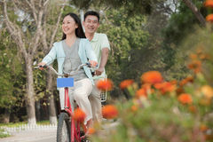 Couple riding tandem bicycle in Beijing Royalty Free Stock Image