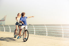 Couple riding on tandem bicycle outdoors stock photo