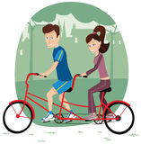 Couple riding tandem bicycle Stock Photography