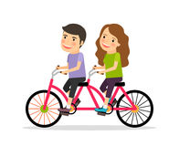 Couple riding tandem bicycle Stock Images